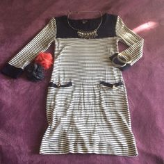 Navy and cream sailor inspired striped dress Super cute sailor navy and cream striped dress with 3 quarter sleeves. Two slip pockets in front with gold button detail. Forever 21 Dresses