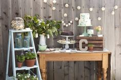 I love this ENTIRE display for a baby shower or spruce it up even more for a bridal shower:)..there are tags on the table for people to write a message and then hang on the tree in the ceramic pitcher..cute!