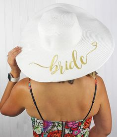 This wide brim floppy sun hat is embroidered with Bride in gold and perfect  for the 9870668811f5