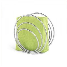 Paper Napkin Holder Spiral Paper Napkin Holder Table art: wiry spirals of nickel-plated steel artistically store linen or paper serviettes of all sizes in concentric slots. The result is oh-so whimsical and contemporary, especially