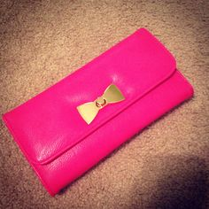 Bright pink clutch. #bow