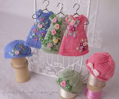 Hand knit and embroidered dress/hat sets for teeny tiny Amelia Thimble dolls.  cindyricedesigns.com