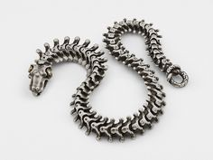 """The unique design of this """"Snake Bones"""" bracelet is modeled on the actual snake vertebrae and is exceptionally detailed. Designed and handcrafted by Anatoly Startsev in sterling silver, 18KT gold with"""