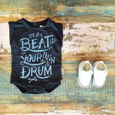 BABY • We're down to the very last of our Feather Drum onesie tees including this gorgeous 'to the beat' print. Styled with a pair of white Converse Baby Chucks, all available at Tiny Style in Noosa & online •  www.tinystyle.com.au