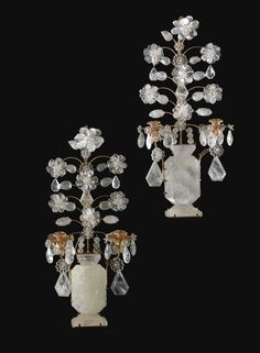 A SET OF FOUR ROCK CRYSTAL AND CUT GLASS-MOUNTED GILT METAL TWO-BRANCH WALL LIGHTS