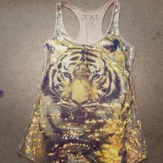 Sequin tiger face tank top Gold sliver and black sequins. Length from shoulder to hem 26 inches. Small discoloration on back Forever 21 Tops Tank Tops