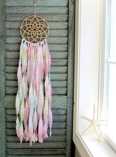 A soft, gentle interpretation of a traditional dream catcher. Sleek, clean lines and earth friendly bamboo matched with soft, flowing batik fabric