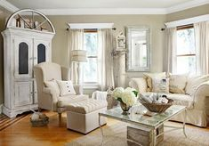 Architectural salvage pieces add character to this Illinois living room. An old arched window graces the top of an armoire, and a chippy old column provides a perch for a lantern. More lovely living rooms: http://www.midwestliving.com/homes/decorating-ideas/living-rooms/?page=4