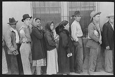 Relief line waiting for commodities, San Antonio, Texas. March 1939. Photographer: Russell Lee.