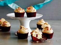 Get Jelly-Filled Cupcakes With Peanut Butter Frosting Recipe from Food Network