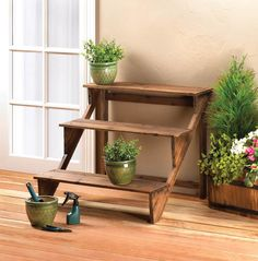 Showcase your green thumb with this three-tiered plant stand thats perfect for any space. Made from fir wood with a rich brown finish, this tri-level stand will help you step up when it comes to displaying your favorite potted plants and flowers. Contents not included.  Item Dimensions: 30.75 x 29 x 24.5. Item Weight: 9.2 lb. Materials: WOOD - FIR. Pack Size: 1 EA. UPC Code: 849179024918. Modern Plant Stand, Diy Plant Stand, Wood Display Stand, Display Shelves, Ladder Display, Display Cases, Plant Shelves, Wood Shelves, Shelving
