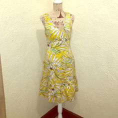 Spense Floral Dress with cutout back w/bow SPENSE DRESS  SLEEVELESS  LINED IN YELLOW  BACK CUTOUT  BACK BOW  HIDDEN SIDE ZIPPER  RUFFLED HEM  COTTON  SPANDEX  SIZE 10  PIT TO PIT  19  WORN ONCE Spense Dresses Midi