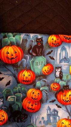 Halloween- pre-quilted black backing, satin binding