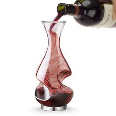 Enhance the flavor and aroma of your favorite wine with this Conundrum aerator and decanter from Final Touch. Made from glass, it has a brushed stainless steel base. This fantastic decanter aerates your wine while you are filling the decanter or serving to your guests. Gifts For Wine Lovers, Wine Gifts, Wine Gadgets, Kitchen Gadgets, Wine Time, Wine And Spirits, Wine Making, Carafe, Wine Recipes