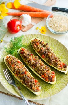 Baked Stuffed Zucchini is an easy, delicious go-to dinner loved by all ages. My husband, who doesn't like zucchini, cleaned his plate!! They are very delicious and #healthy. #paleo #glutenfree