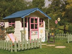 Beautiful playhouse: we used Cuprinol Garden Shades in Porcelain Doll, Coral Splash and Inky Stone with Misty Lawn on the fence