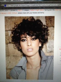 Cool haircut for short curly hair.