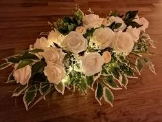 One of our 4 feet long wedding top table flower arrangements. Silk cream and white roses mixed with green foliage and tiny LED lights hidden amongst the flowers create a gentle pool of light for your wedding reception. Available to hire from www.limelightweddings.co.uk Wedding Top Table, Wedding Post Box, Wedding Hire, Wedding Reception, Wedding Lanterns, Marquee Wedding, Wedding Decorations, Top Table Flowers, Table Flower Arrangements