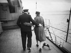 Winston Churchill and his daughter Mary walking arm in arm aboard HMS DUKE OF YORK in the Clyde, shortly before the Prime Minister left for the United States, December 1941