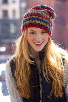 This adorable knit hat pattern has a classic striped design and fits loosely on your head. The Positively Red Hook Hat is a cute, slouchy ribbed hat that features alternating stripes of red, blue, and lime green colors.