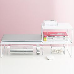 Enjoy free shipping on all purchases over $75 and free in-store pickup on the Franklin Desk Risers at The Container Store. Made of strong steel with a smooth white paint coating, this modern Franklin Desk Riser can be used to either maximize desk space, shelf space or under counter space depending on your needs. Its clean design doubles as a monitor stand, allowing you more room for work space and raising your monitor to eye level for greater comfort.