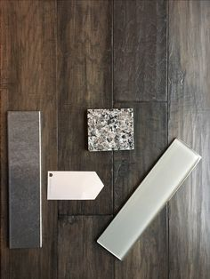 Our palette!  Mountain View Hickory hardwood flooring in Smoke, Caledonia Granite, Requisite Grey Sherman Williams paint, light grey glass subway tile and dark grey porcelain floor tile.