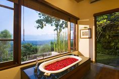 Enjoy the scenery while soaking in this Bali themed bathroom. The Longhouse in Jimbaran, http://www.villa-bali.com/en/villa/jimbaran/villa-longhouse