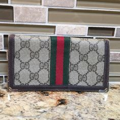 Authentic Vintage Gucci Check book Wallet- 70's Authentic Vintage Gucci Check book Wallet from the 70's. This wallet does show wear- price reflects condition. Exterior has some fading to canvas and edges show wear- please see photos. Feel free to text me for a faster reply 310-272-6284 Gucci Bags Wallets