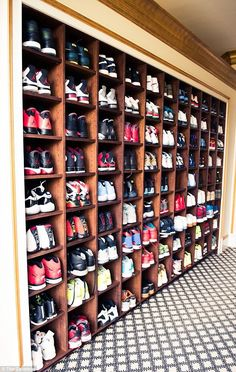 Wall-to-wall: The 40-year-old rapper has several large closets featuring many rare Air Jordans and other trainers