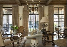 LOVE, LOVE, LOVE the entire concept...furnishings, color tone, windows, lighting, ceiling, French doors, drapes and, and, and....