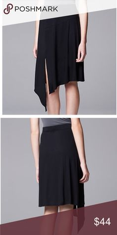 Asymmetrical black skirt NWT! PRODUCT FEATURES Side slit adds a flirty touch Soft jersey construction  FIT & SIZING 23-in. approximate length at the shortest point 31 1/2-in. approximate length at the longest point Elastic waistband FABRIC & CARE Polyester, spandex Machine wash Simply Vera Vera Wang Skirts Midi