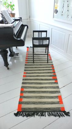 Handwoven runs in sheep's wool in the home with piano.     Designs: kira-cph.com . Size: 70 × 220 cm, price: £ 2300