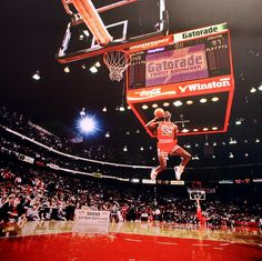 Michael Jordan leaps from the free-throw line for a perfect-score dunk in the 1988 NBA Slam Dunk Contest./SI) GALLERY: SI's 100 Best Michael Jordan Photos Jordan 23, Michael Jordan Slam Dunk, Michael Jordan Sign, Michael Jordan Photos, Air Jordan Iii, Jeffrey Jordan, Jordan Shoes, Robert Jordan, Jordan Logo