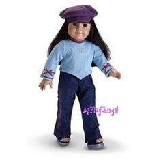 2003 Glitter Jeans Outfit    Your American Girl will sparkle in glitter jeans and a ribbon-trimmed top with rhinestone graphic.  Finish her look with platform slides and a faux-suede newsboy hat.    GPOG      discontinued 2005