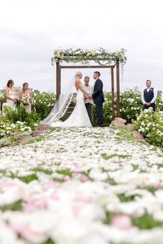 Surrounded by friends, family, and an abundance of white flowers, the couple got married at Gerry Ranch in Camarillo, California.