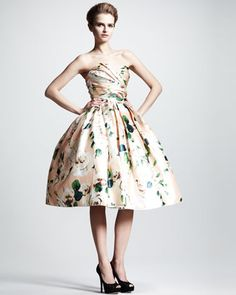 neiman marcus    Dramatic Dolce & Gabbana dress features an elegant floral print and a widely flared skirt.•Floral print.  •Strapless neckline; pleated bust.  •Ruched bodice.  •Flared, pleated skirt.  •Includes detachable tulle skirt.  •Silk.  •Made in Italy.