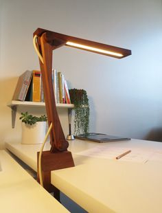 A fully articulating LED task lamp, made of walnut, sourced from the Chicago design and manufacturing community.
