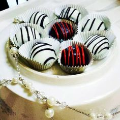 delicious truffles that look almost as good as they tasted. yum yum #yummy #redandblack #truffles #chocolate #desserts #Raufcreations