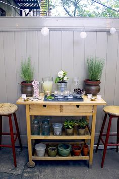 Turn the FORHOJA kitchen island from IKEA into a double-duty island for stocking cocktail essentials and storing potting supplies.