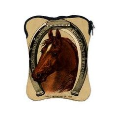 Horse iPad Sleeve  A beatifully illustrated horse is the focus of this vintage advertisement for liniment. The gorgeous horse head is surrounded by a horse shoe.