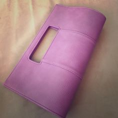 Adorable clutch Lilac colored clutch.  Material is PU.  Magnetic snap closure, fabric interior. 2 pockets and middle zip closure inside.  Brand new with tag, never been used.  Tiny rip in the corner as seen in last photo. Charming Charlie Bags Clutches & Wristlets