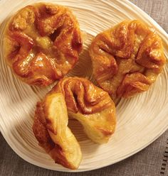 Gourmet Butter Puffs - A French-inspired, elegant, hand-folded rosette made with layers of croissant pastry surrounding a sweet filling of butter and caramelized sugar.