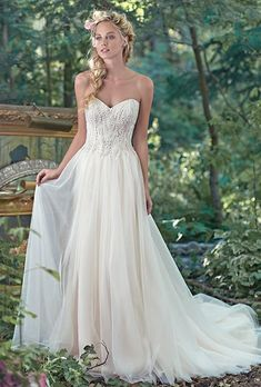 Maggie Sottero. See more details from Maggie Sottero��Sparkling Swarovski crystals, pearls, and sequins adorn the bodice of this wedding dress, trailing into a whimsical A-line tulle skirt. Finished with sweetheart neckline and covered buttons over zipper and inner corset closure.