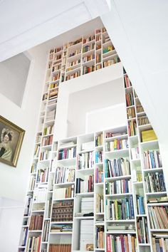 We all may not have an impressive wall like this, but that doesn't mean we can't take inspiration from how cool this segmented full length book wall looks!