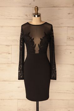 This form-fitting black cocktail dress features a plunging neckline and long sleeves of mesh and lace for overall coverage while still provocative. A great little black dress for a daring yet conservative look. #cocktaildress