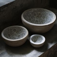 Give an unexpected sure-to-please gift with these Floral Lined Bowls. Crafted from cement and starting at only $25. teakwarehouse.com.
