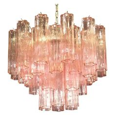 For Sale on - Italian vintage chandelier in Murano glass and nickel-plated metal structure. The armor polished nickel supports 36 large pink glass tubes in a star shape.