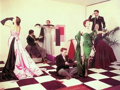 Evening ensembles from the Paris collections of 1951. Left to right: model in pink and aubergine satin by Schiaparelli, model in lace by Balenciaga, Bettina in green satin by Jacques Fath and model in wine velvet by Jean Dessès