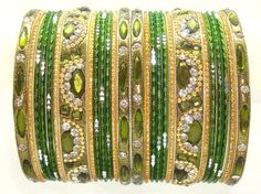 Beautiful Mehendi Green and Gold Color Indian Bangles Belly Dance Costume Bracelet Set Product Code :Indian Bangles Set 29 The Bangles Set Contains 26 individual Bangles Colors & Design: (As Per Images) Quantity: 1 Bangles Set Base Material : Alloy Metal & Lac decorated with different stones and Kundan and Age Group : Adult,Kids Price $USD   16.99
