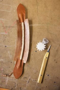 Stitching a leather handle...Louis Vuitton family home « the selby